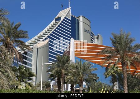 DUBAI, UAE - NOVEMBER 23, 2017: Jumeirah Beach Hotel in Dubai. The hotel was designed by British company WS Atkins. It is operated by Jumeirah Group. - Stock Photo