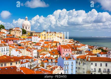 Lisbon, Portugal city skyline over the Alfama district. - Stock Photo