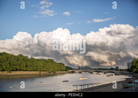 Huge cumulonimbus cloud (big fluffy storm cloud) over the River Thames in South West London (near Putney and Fulham) - Stock Photo