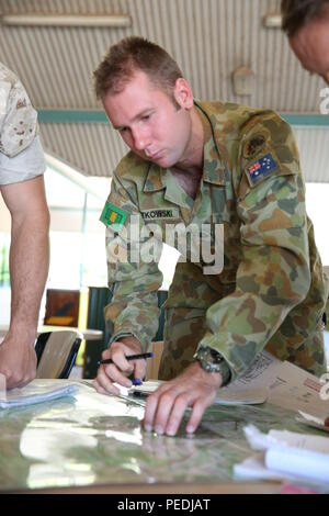 Australian Army soldier PTE Craig Rutkowski, a rifleman with Delta Company, 5th Battalion, The Royal Australian Regiment, 1st Brigade, Australian Defence Force, plots points on a map during an operations order class Aug. 5 at Robertson Barracks, Palmerston, Northern Territory, Australia. The course was overseen by 5 RAR leaders and staff noncommissioned officers with MRF-D. The course was an excellent opportunity to improve Marines' knowledge of the ADF military training, which ultimately strengthens our interoperability. (U.S. Marine Corps photo by Cpl. Reba James/Released) - Stock Photo