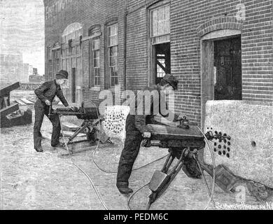 Black and white engraving showing two men using a pair of Edison Electric Rock Drills to drill into stone slabs mounted at the base of a large brick building, from Volume 65, Number 20 of the journal 'Scientific American', 1891. Courtesy Internet Archive. () - Stock Photo