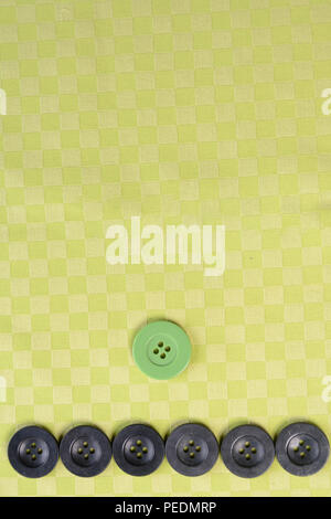 Black buttons on a green texture background 2018 - Stock Photo