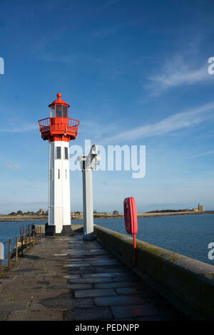 Red-white lighthouse in Normandy, France - Stock Photo
