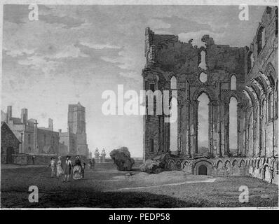 Black and white print showing a view of the ruined, medieval 'Tynemouth Priory' or monastery, located on Pen Bal Crag, looking over Tynemouth Pier in Northumbria, England, with several people in eighteenth-century clothing at left, and a larger structure in the distance, engraved by William Byrne after a drawing by T Hearne, 1825. Courtesy Internet Archive. () - Stock Photo