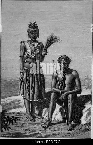 Black and white illustration of a pair of Zulu people, the man, wearing a hat, holding a spear, and sitting on a rock, bare-chested and bare-footed, with a woman standing next to him wearing a skirt and a vest laden with objects, possibly amulets, and holding feathers or sheaves of a plant in her hand, from the volume 'De Angola a contra-costa, descripcao de uma viagem atravez do continente africano', 1886. Courtesy Internet Archive. () - Stock Photo