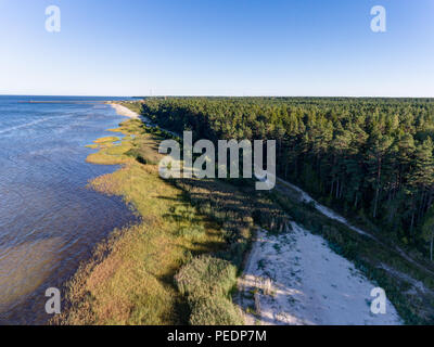Drone image. aerial view of red sunset in the sea beach. shore line. baltic sea at dust - vintage retro look. Photo taken in Latvia. - Stock Photo