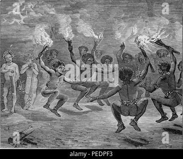 Black and white print depicting a group of New Guinean men holding lit torches and dancing in a circle while other figures look on from the background, including a pair of men at far left who appear to be playing local instruments, published in John George Wood's volume 'The uncivilized races of men in all countries of the world, being a comprehensive account of their manners and customs, and of their physical, social, mental, moral and religious characteristics', 1871. Courtesy Internet Archive. () - Stock Photo