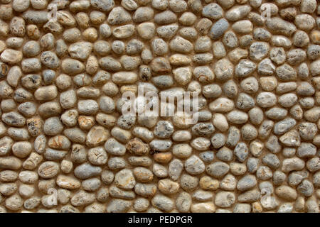 Medieval wall made of pebbles laid in mortar, old town of Norwich, UK. - Stock Photo