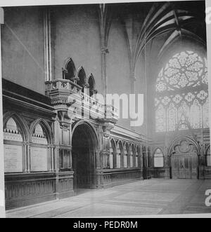 Black and white photograph showing an interior view, looking toward the south door and windows of the Memorial Transept at Memorial Hall, a late 19th-century Gothic revival building built to honor Harvard men who died in the Civil War, located north of Harvard Yard in Cambridge Massachusetts, 1875. Courtesy Internet Archive. () - Stock Photo