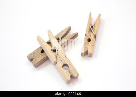 Wooden clothespin on a white background - Stock Photo