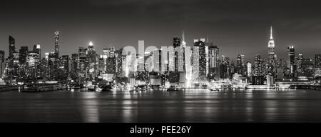 Panoramic Black & White view of Midtown West skyscrapers with the Hudson River. Manhattan, New York City - Stock Photo