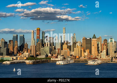 The skyscrapers of Manhattan Midtown West with the Hudson River in afternoon light. New York City - Stock Photo