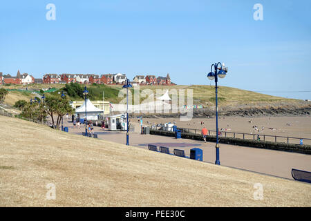 Parched grass and lawns at Barry Island, Wales, at the height of the 2018 heatwave - Stock Photo