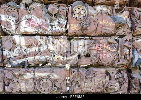 Crushed cars used as building blocks to build a wall at car park in Heath Mill Lane, Digbeth - Stock Photo