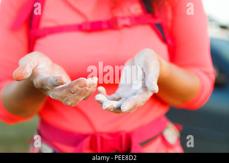 Photo of woman climber with talc on hands - Stock Photo