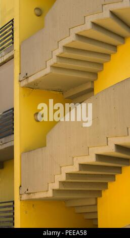 Modern rounded stairs in a yellow building (Pesaro, Italy, Europe) - Stock Photo
