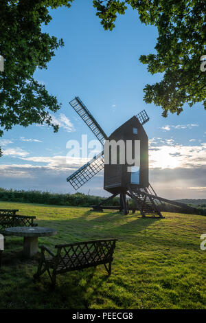 Beautiful landscape image of Nutley Windmill in Ashdown Forest Southern England during Summer sunset - Stock Photo