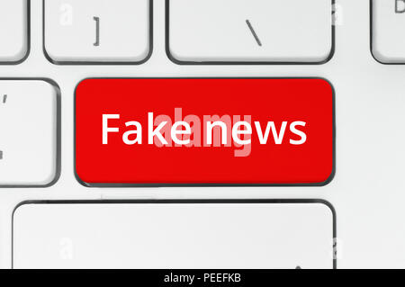Fake News concept. Red button with Fake News words on the keyboard close-up - Stock Photo