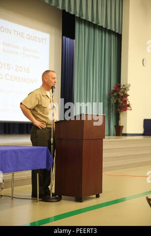 Colonel Peter D. Buck addresses teachers aboard Laurel Bay family housing during an opening ceremony for the new school year at Middleton S. Elliott Elementary School, Aug. 10. Buck expressed his gratitude toward the Laurel Bay school system for their support to the community. Buck is the commanding officer for Marine Corps Air Station Beaufort. (U.S. Marine Corps photo by Lance Cpl. Jonah Lovy/Released) - Stock Photo