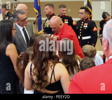 Pvt. John Wentling, Honorary Marine, shows his eagle, globe and anchor to his grandchildren at the American Legion Post 34 on Aug. 8, 2015.