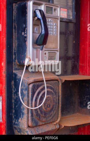 Interior of an old red British public telephone box - Stock Photo