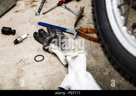 Tools for repairing motorcycle and gloves close up - Stock Photo