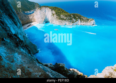 Navagio beach or Shipwreck bay with turquoise water and pebble white beach. Famous landmark location. Landscape of Zakynthos island, Greece - Stock Photo