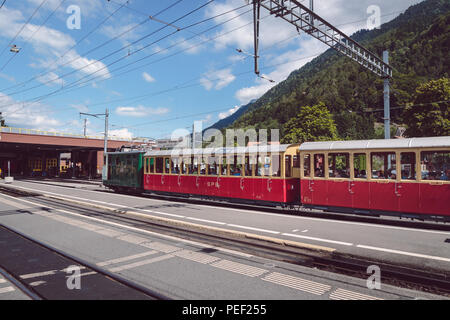 Wilderswil, Bernese Oberland, Switzerland - AUGUST 5, 2017 : retro passenger train arrives in the Wilderswil railway station near Interlaken from Schy - Stock Photo