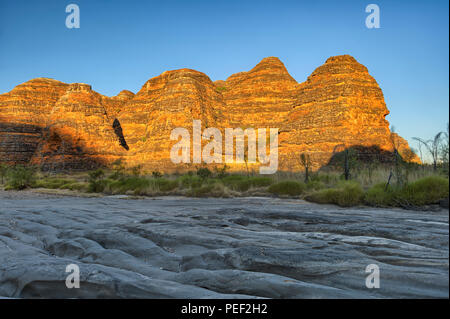 Beehives and Piccaninny Creek in warm morning light, Bungle Bungles National Park, Northern Territories, Australia - Stock Photo