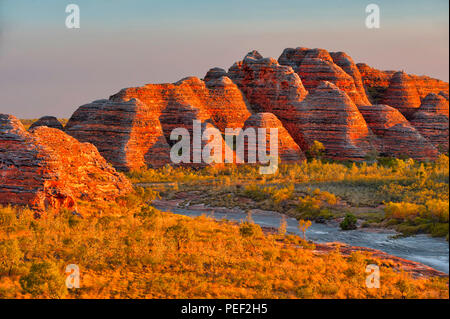 Beehives and Piccaninny Creek in warm evening light, Bungle Bungles National Park, Northern Territories, Australia - Stock Photo