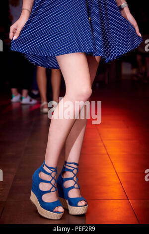 Close-up of  female legs dancing on the dance floor. - Stock Photo