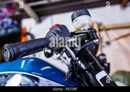 Detail on a modern motorcycle in the workshope. Motorcycle Exhaust. selective focus. Closed up and selected focused of big motorcycle engine and other - Stock Photo