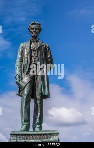 Edinburgh, Scotland, UK - June 13, 2012: Just the Abraham Lincoln bronze statue on Old Calton Cemetery isolated against blue cloudy sky. - Stock Photo