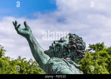Edinburgh, Scotland, UK - June 13, 2012: Just the face and begging hand of the black slave at the Abraham Lincoln bronze statue on Old Calton Cemetery - Stock Photo