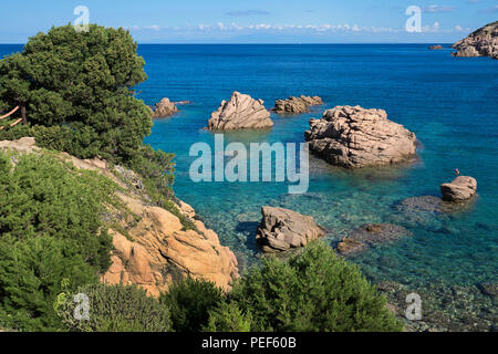 Reddish porphyry rocks at the rocky coast of Costa Paradiso, Sardinia, Italy - Stock Photo