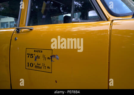 Detail of door with rates display of New York City vintage Checker taxicab - Stock Photo