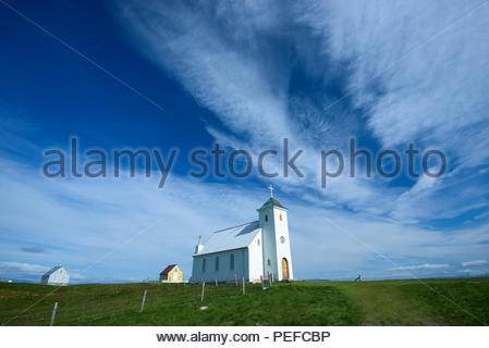 A church on Flatey Island, the largest island of the western islands, located in Breidafjordur on the northwestern part of Iceland. - Stock Photo