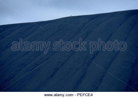 Hikers on Hverfjall volcano cone formed during eruptions 2,500 years ago. - Stock Photo