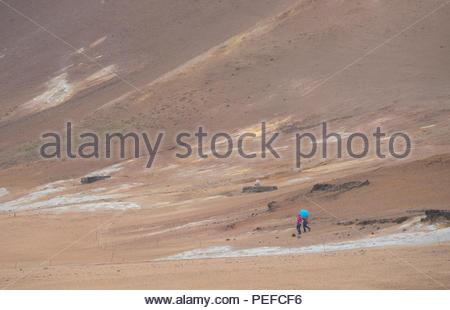 Tourists at the Hverarond mud pots. - Stock Photo