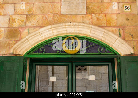 10 May 2018 A modern door arch on an ancient building close to the Via Dolorosa in the walled city of Jerusalem Israel - Stock Photo