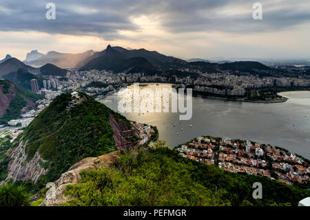 Photo taken in Rio de Janeiro, Brazil August 2017: View from Sugarloaf Mountain over the City during sunset - Stock Photo
