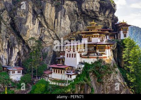 Beautiful view of Buddhism religion with Dzongh and Tigers Nest on a sunny day. Photo taken in Bhutan and showing unique culture and religion. - Stock Photo