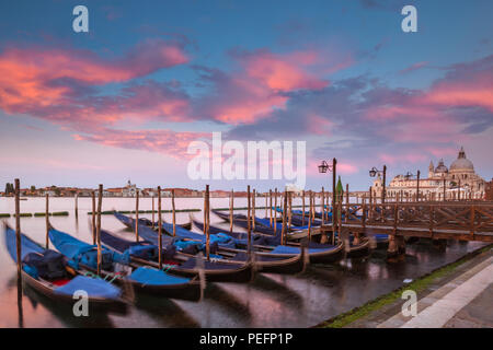 Gondolas parkked at sunset in Venice, Italy - Stock Photo