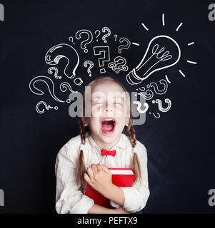 Little genius portrait. Kids education and ideas concept. Little girl with lightbulb and question marks - Stock Photo
