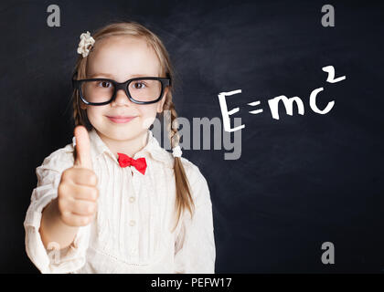 Little genius portrait. Kids mathematics education concept. Little girl with thumb up on hand drawings math science formula pattern - Stock Photo