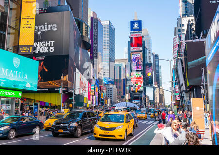 People and traffic at Times Square in New York City - Stock Photo