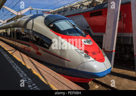 Moscow, Russia - May 3, 2018: High speed Sapsan train on a platform at Lenigradsky railway station ready to depart from Moscow to St. Petersburg. - Stock Photo