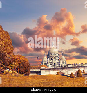 Basilica of Sacre-Coeur in Montmartre, Paris, France, early in the Autumn - Stock Photo