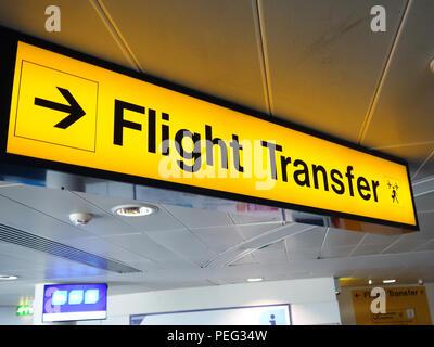 Illuminated Flight Transfer direction sign at Manchester International Airport - Stock Photo