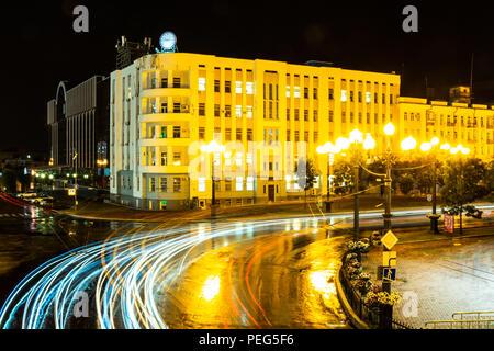Khabarovsk, Russia - August 13, 2018: Lenin square at night under the light of lanterns. - Stock Photo
